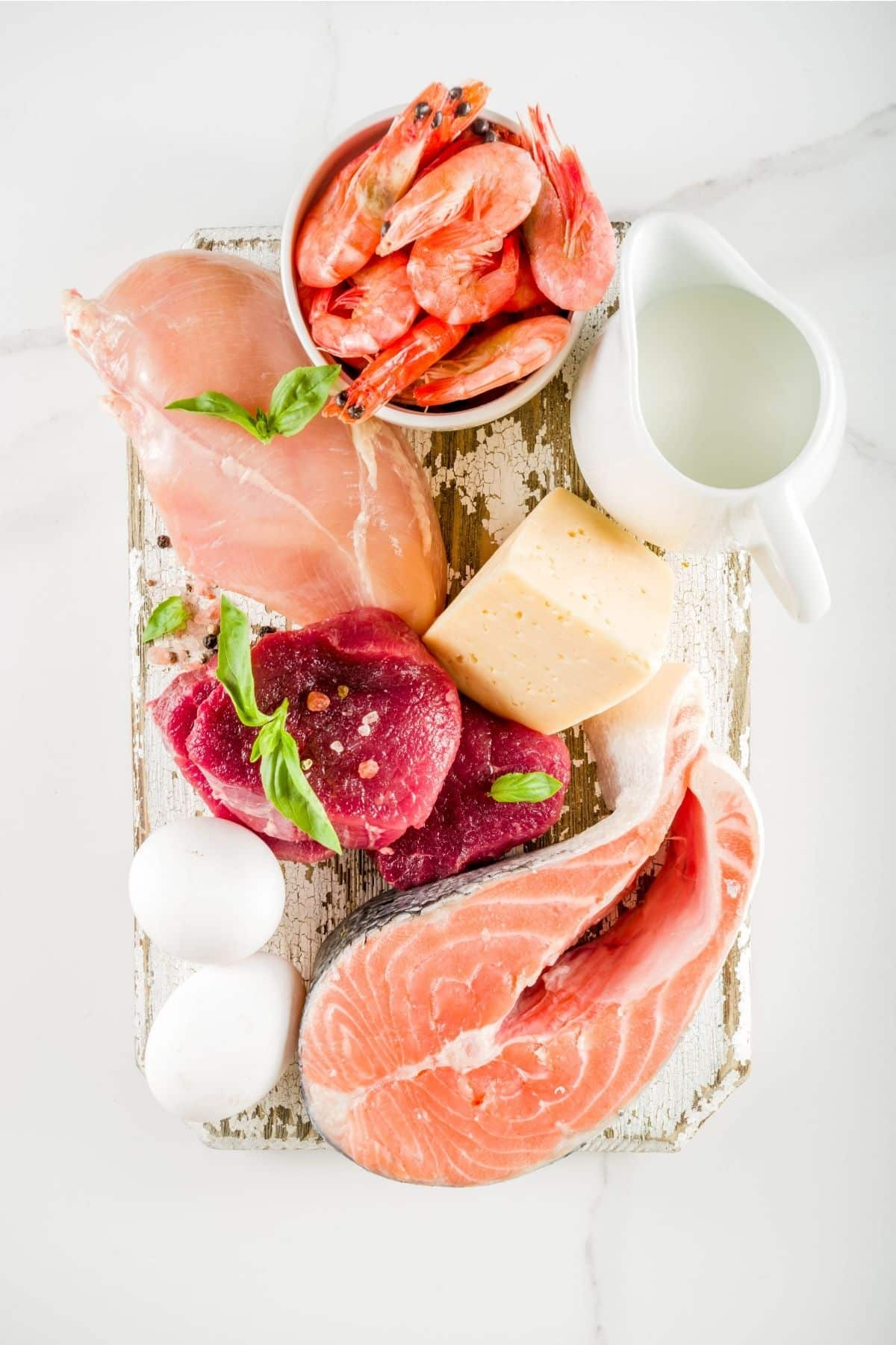 Raw chicken, meat and fish on wood
