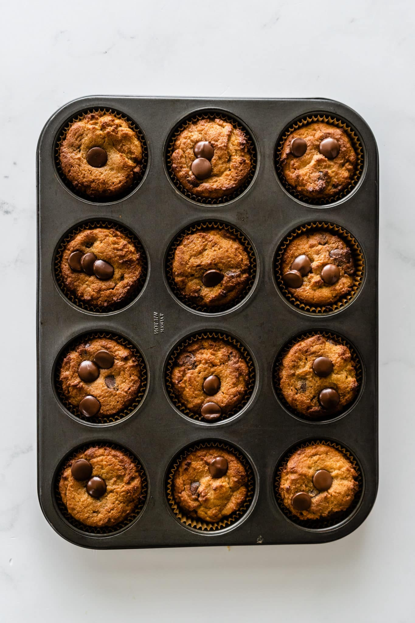 baked coconut flour muffins in muffin tin
