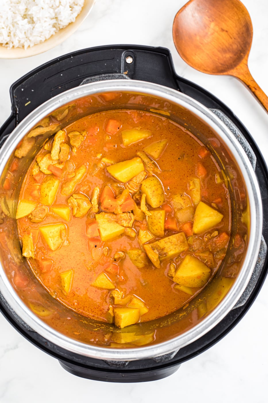 instant pot cooked curry with serving spoon