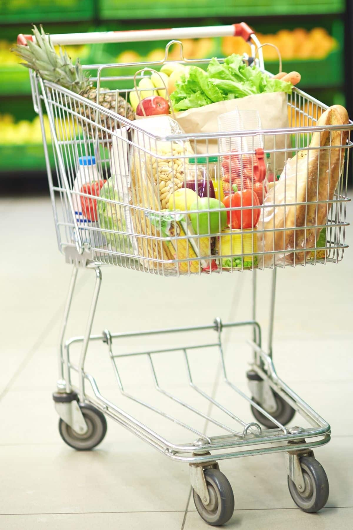 grocery cart filled with healthy foods