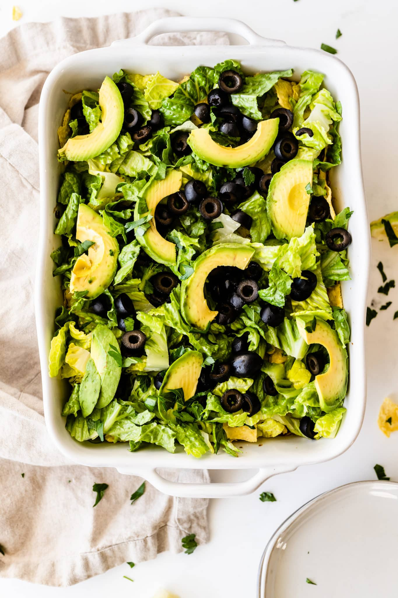 Vegan taco casserole with lettuce, olives, and avocado