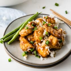 a plate of chicken teriyaki with rice