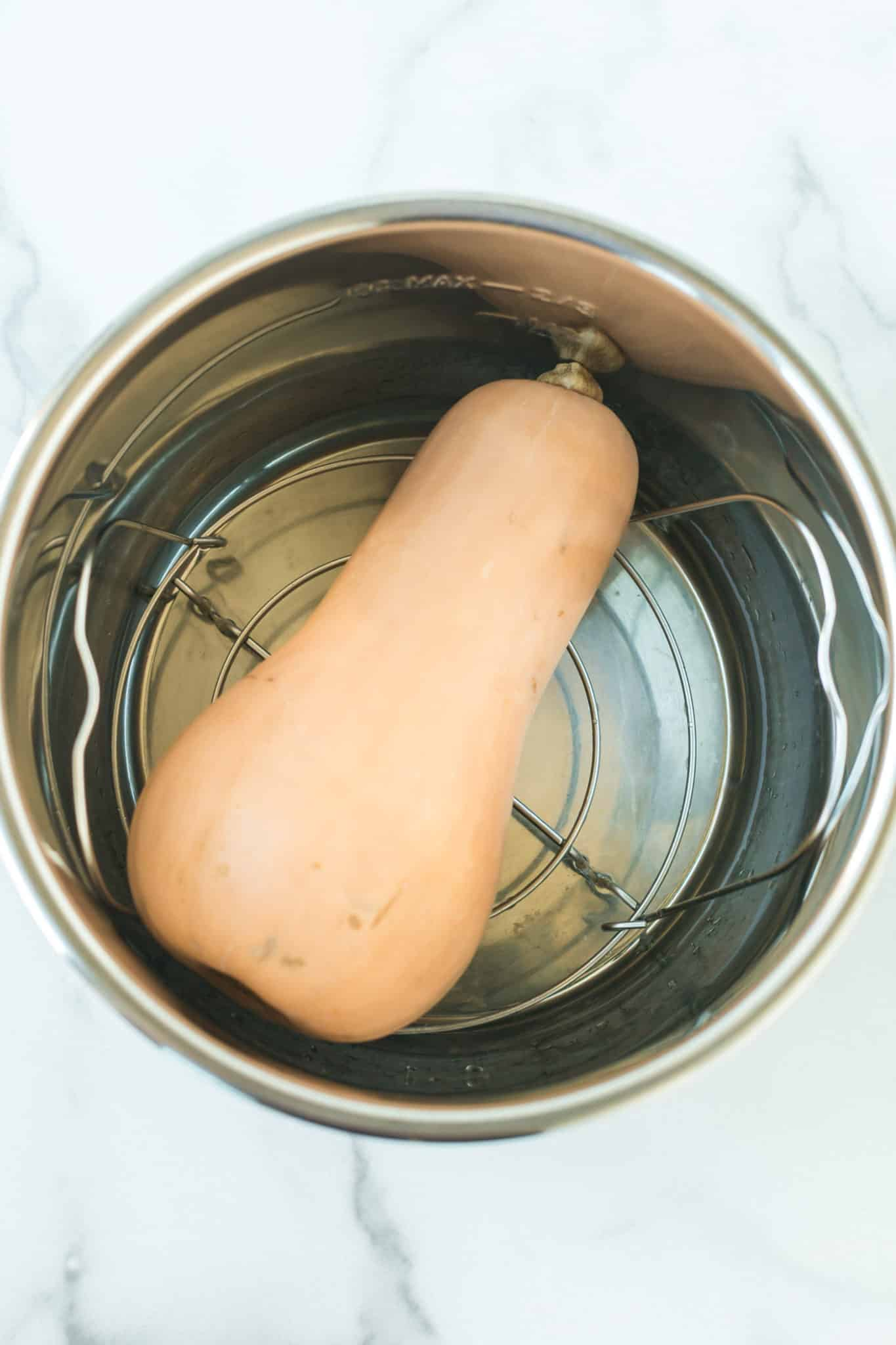 whole butternut squash inside of an instant pot pressure cooker
