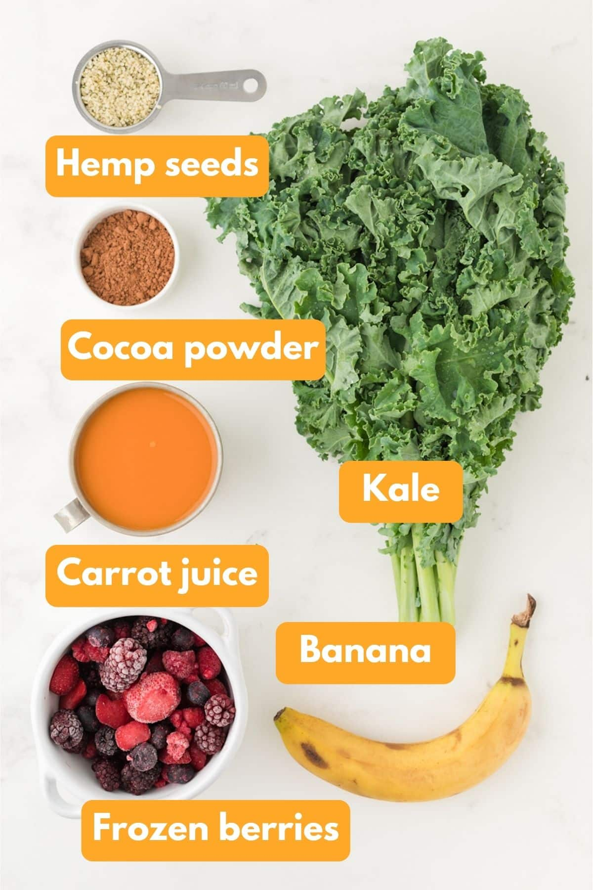 Ingredients for a chocolate berry kale smoothie on a table
