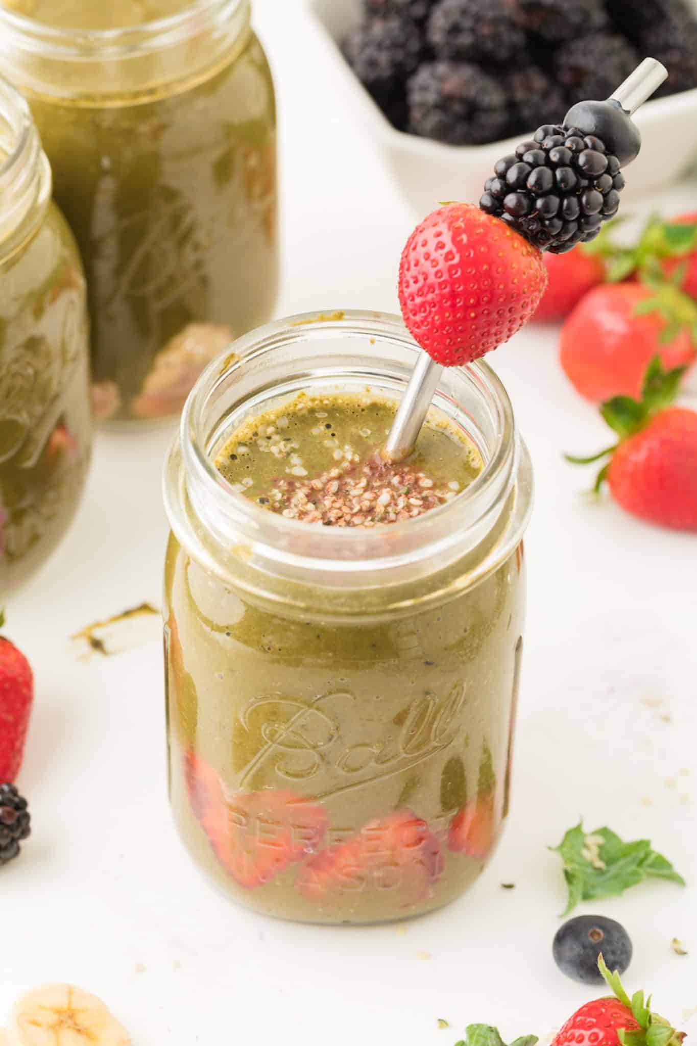 A kale berry chocolate smoothie served in a ball jar