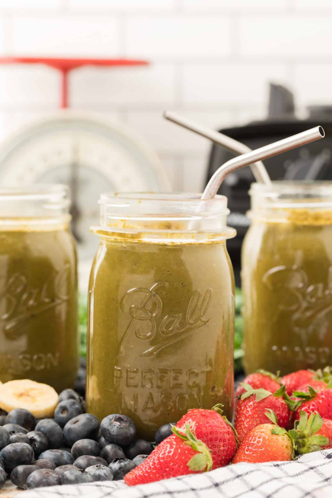 Berry kale smoothies served in three ball jars