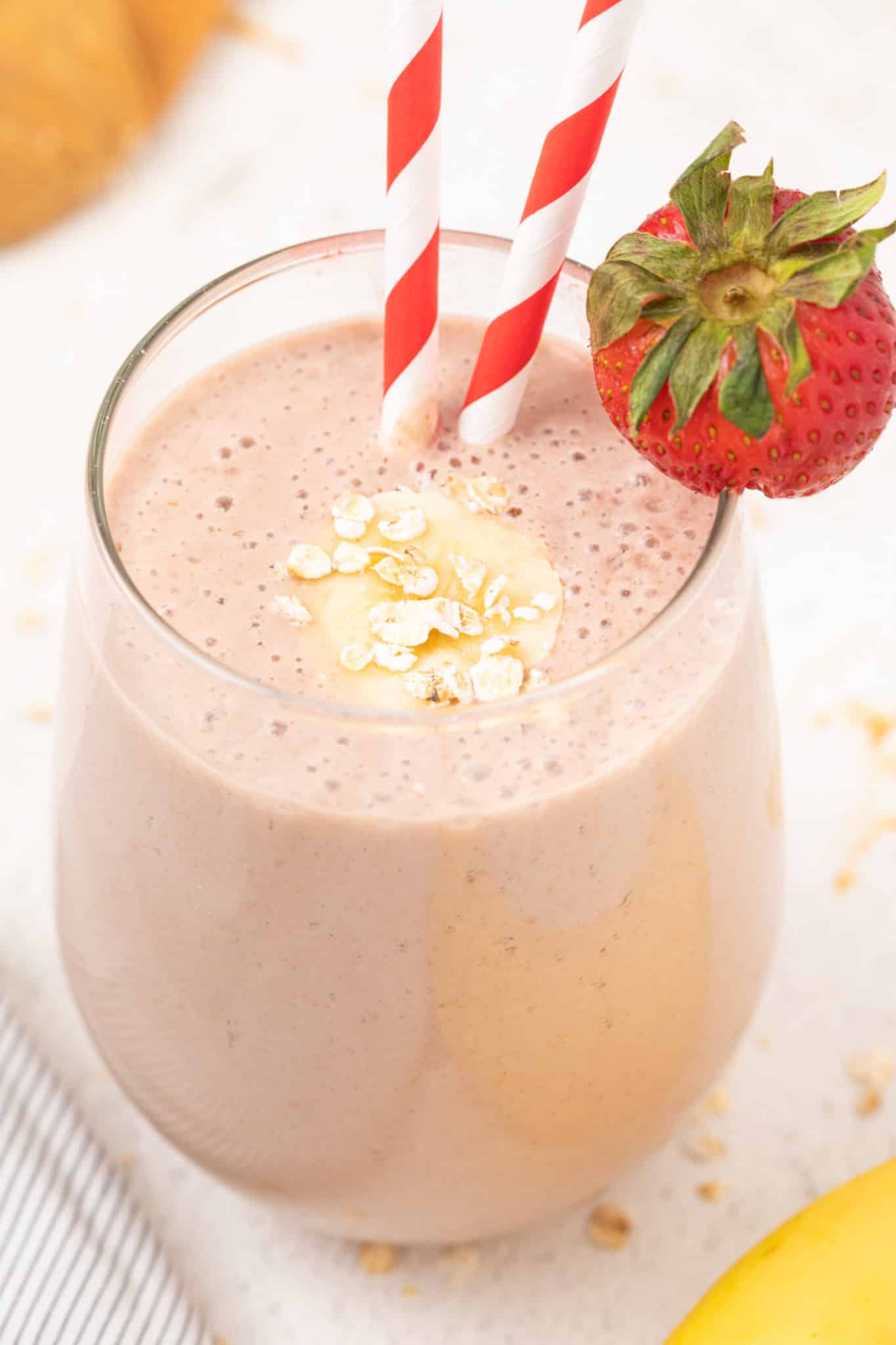 Oat milk strawberry banana smoothie served in a glass