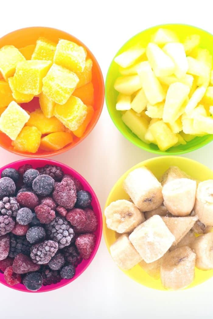 Bowl of frozen bananas, berries, mango, and pineapple