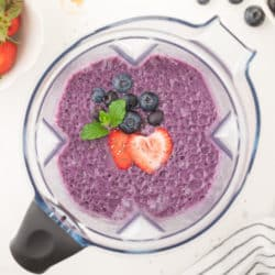 strawberry blueberry smoothie in a blender
