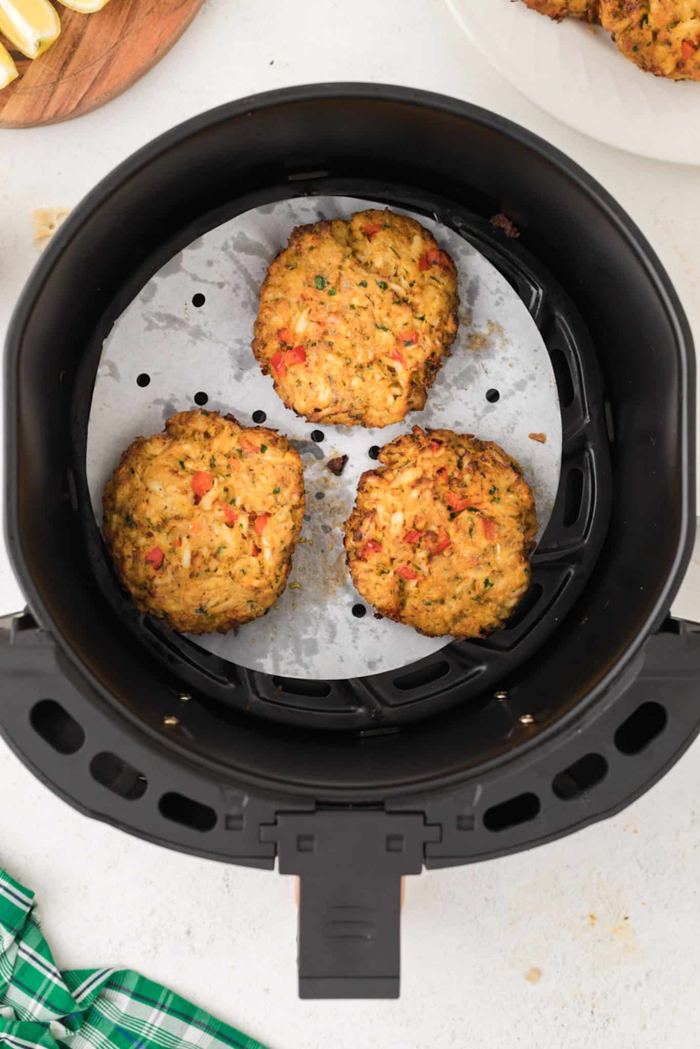 cooked crab cakes in an air fryer