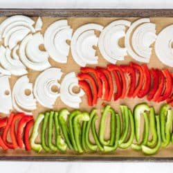 sheet pan of sliced peppers and onions