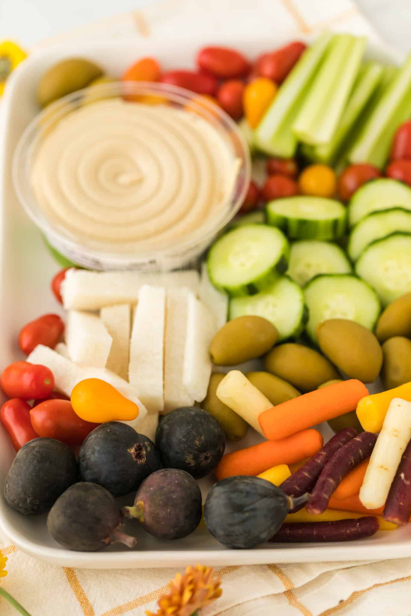 hummus vegetable tray with lots of veggies of various types