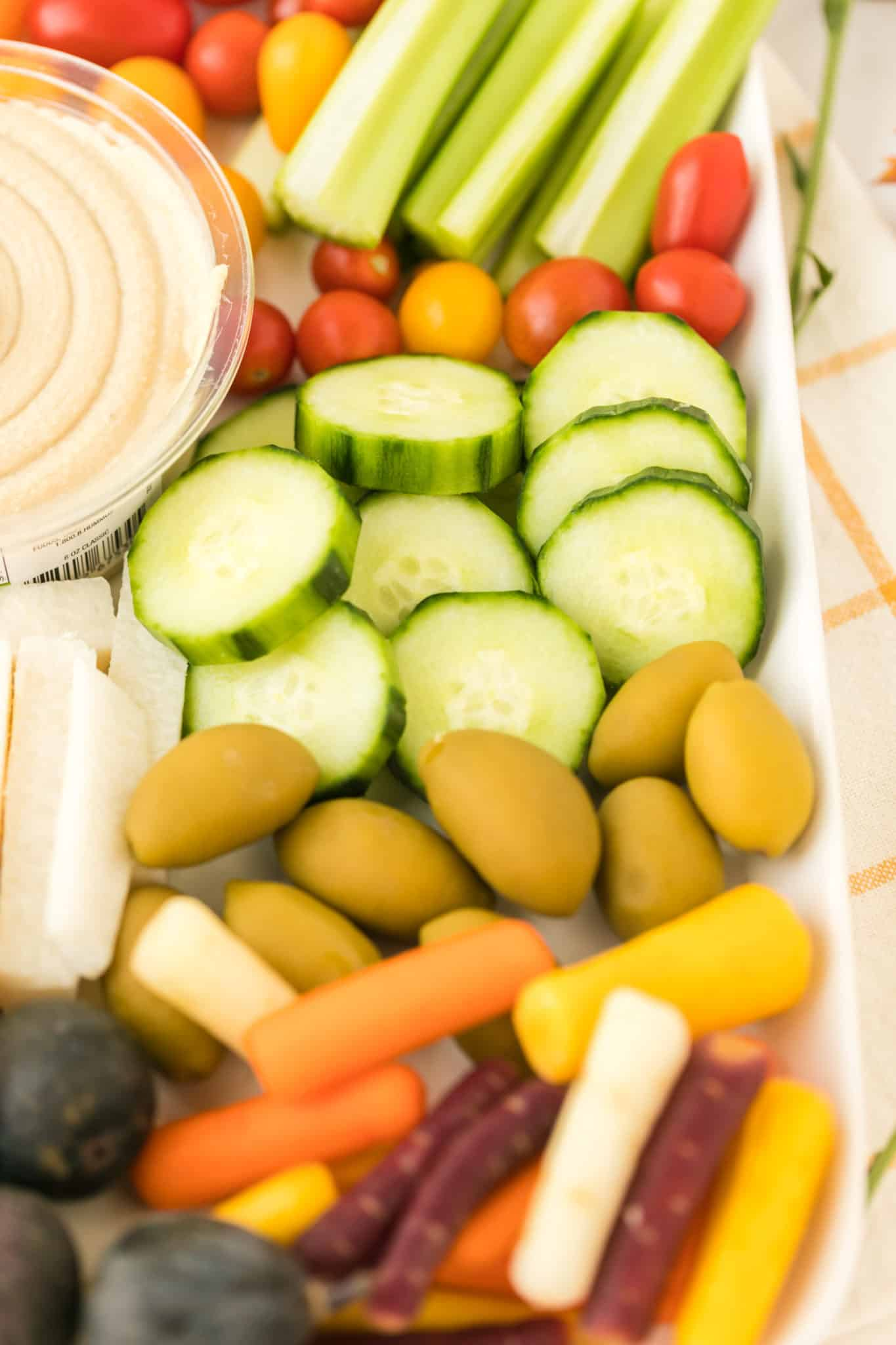 cucumber, olives, carrots, and more on a vegetable plate
