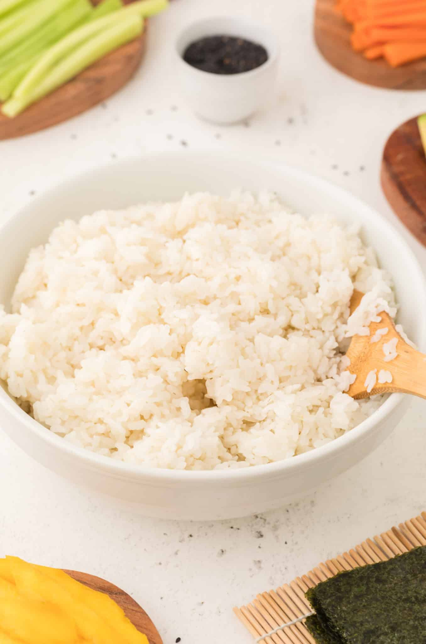 A bowl of cooked sushi rice