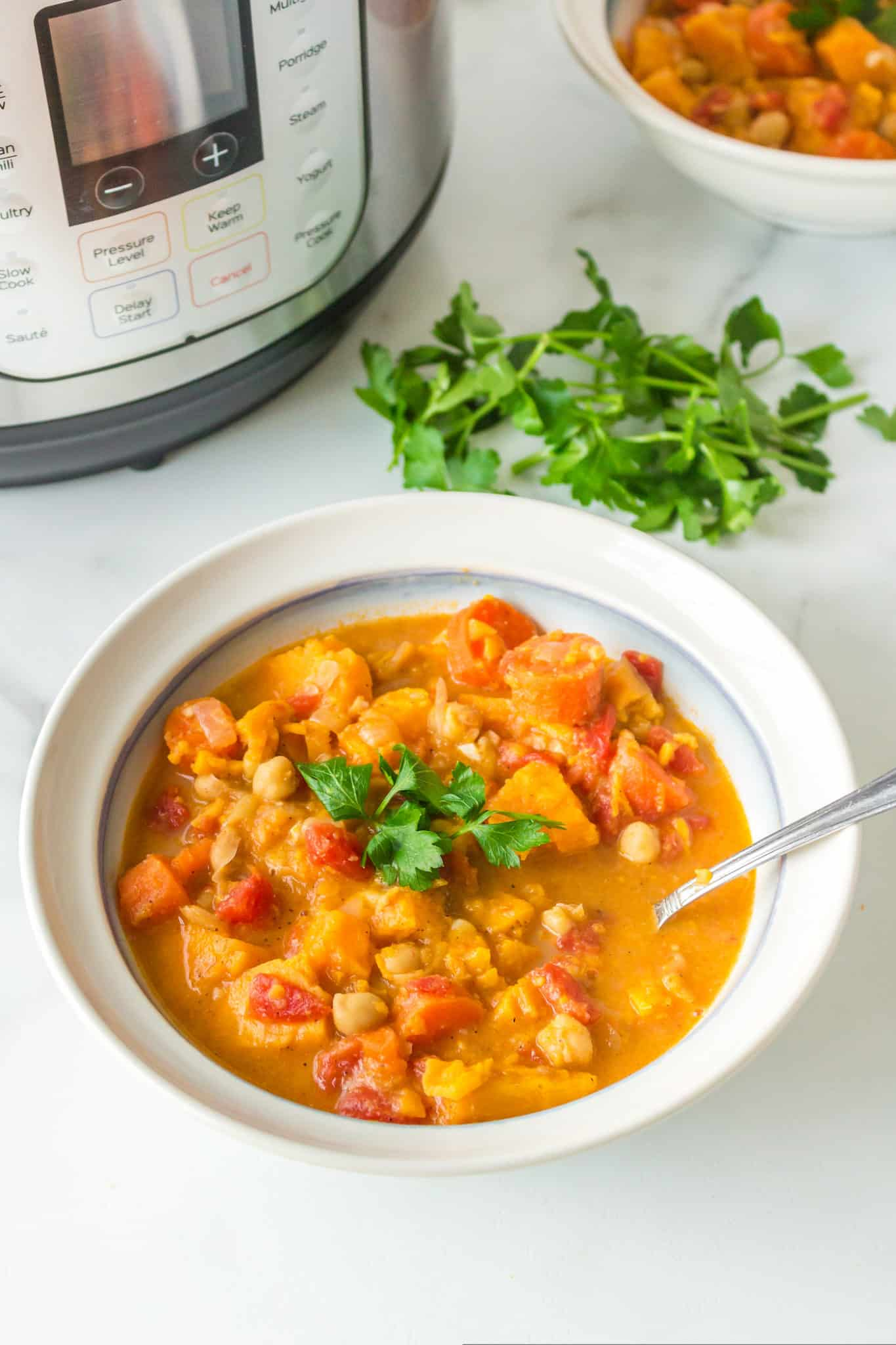 A bowl of instant pot vegan stew topped with fresh parsley
