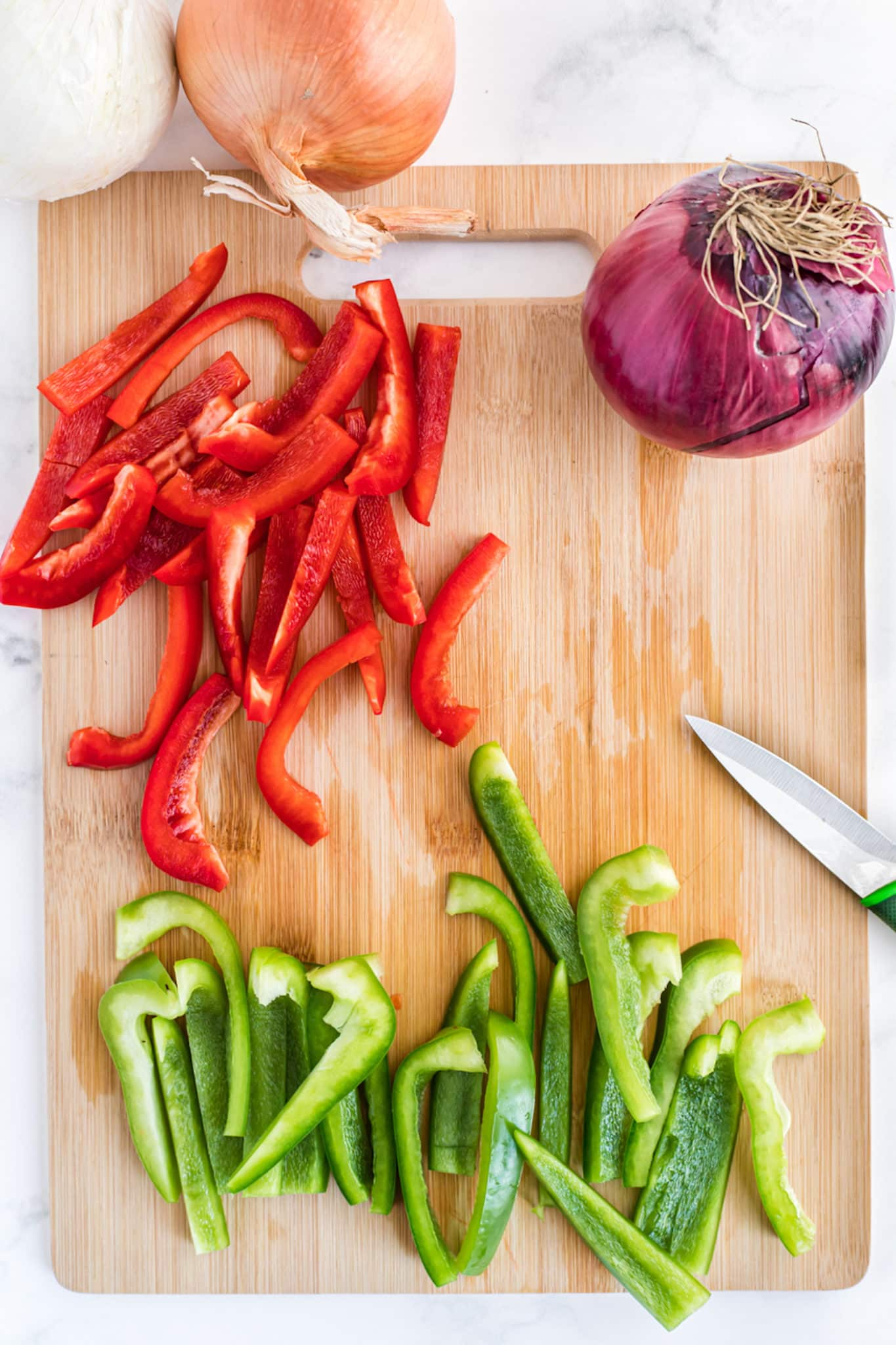 Sliced bell peppers on a cutting board