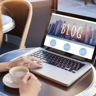 woman writing on her blog