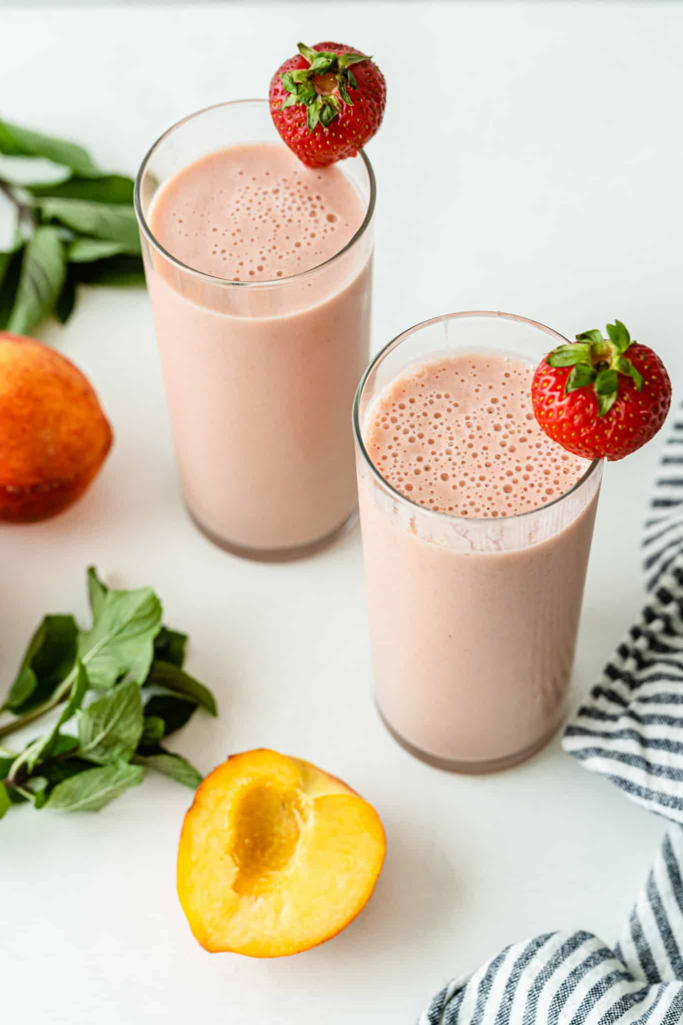 two glasses of strawberry peach smoothies