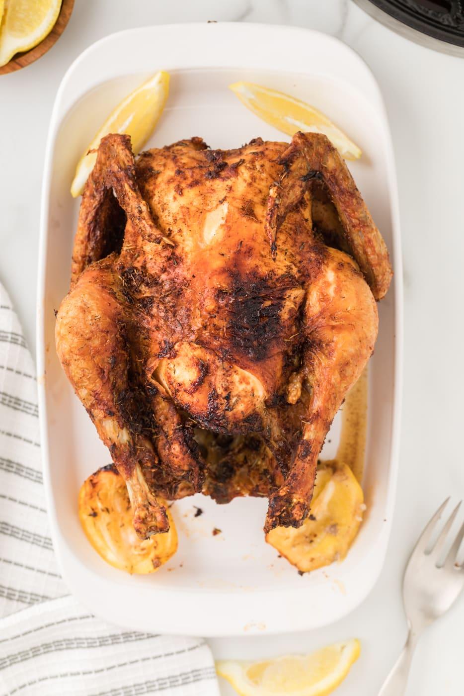 Air fryer roast chicken in a serving dish