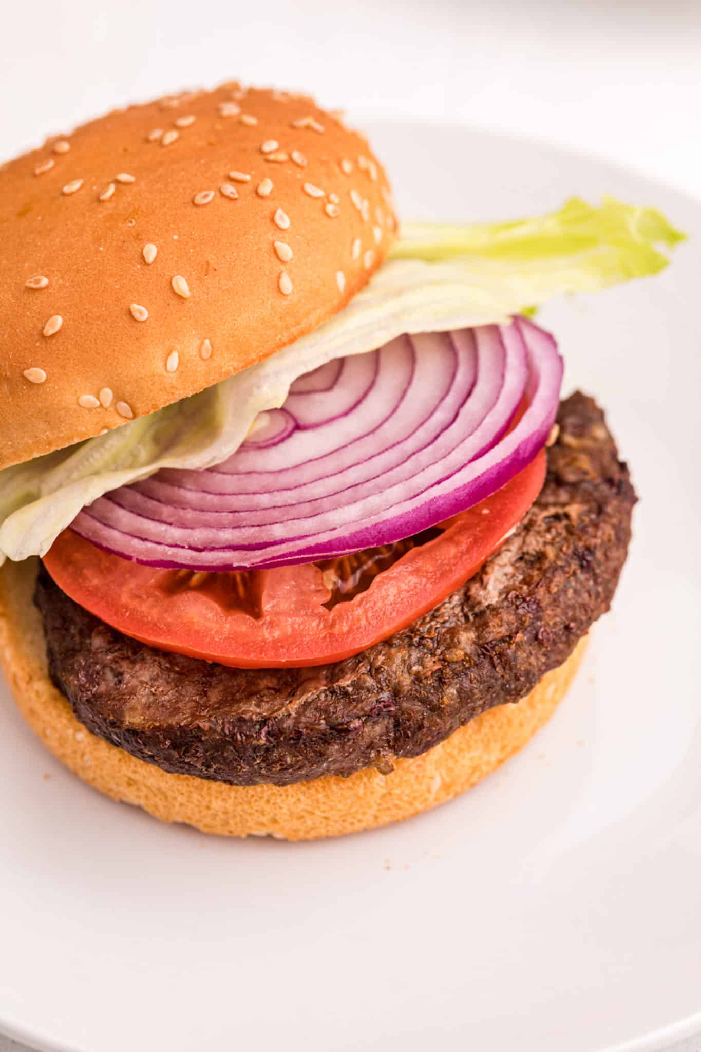 A air fryer hamburger with onion and tomato
