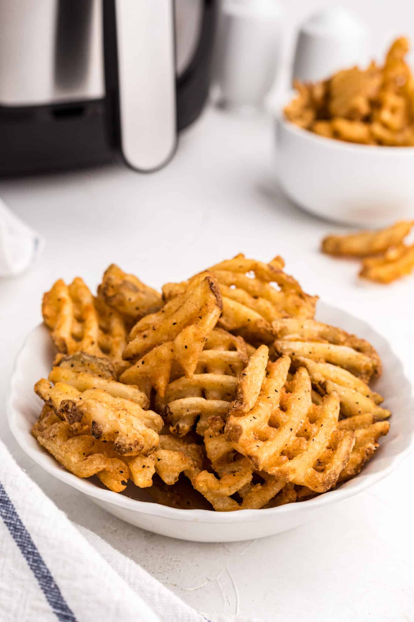 A bowl of air fried waffle fries