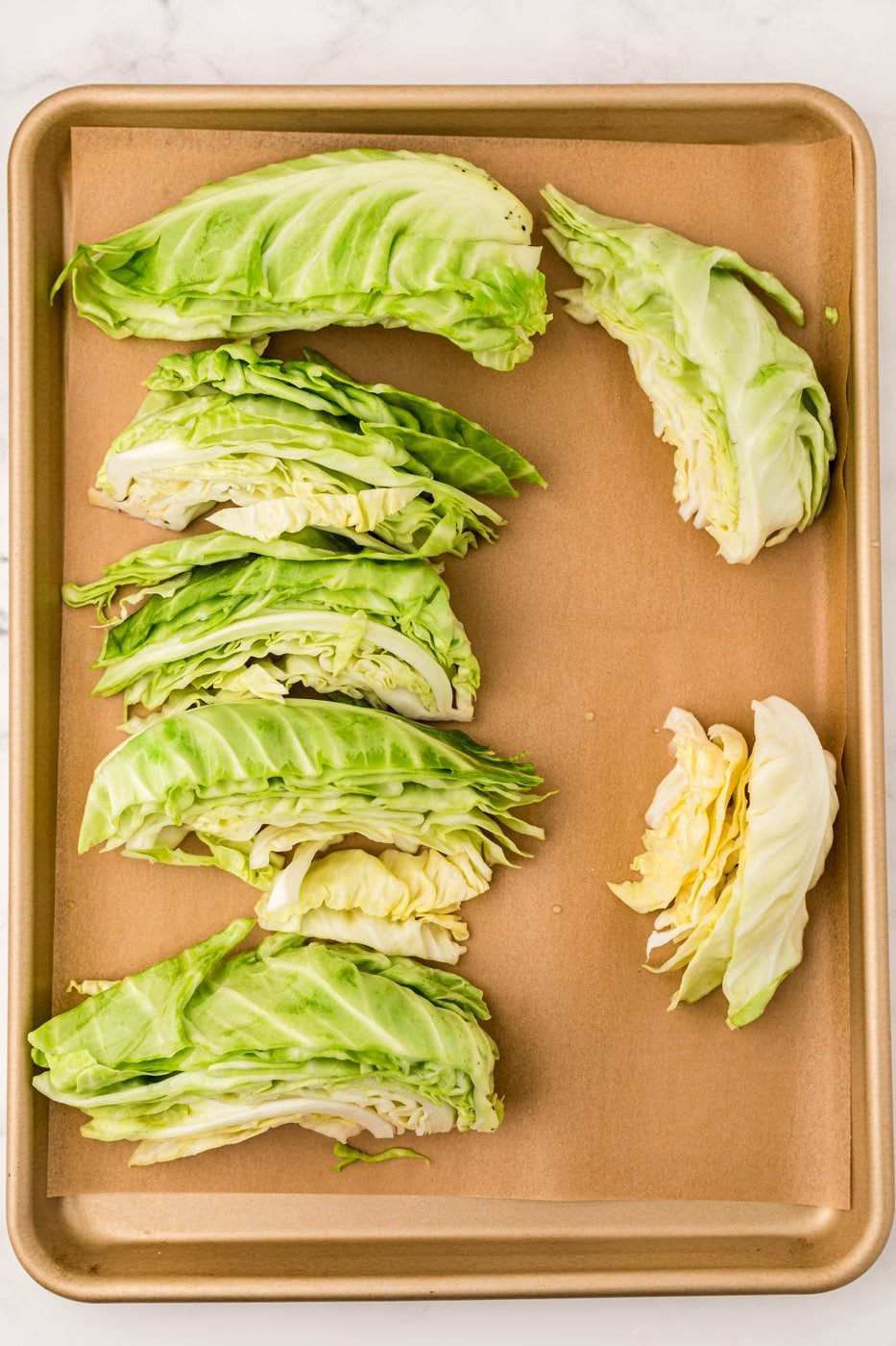 blanched cabbage on baking sheet ready to be frozen