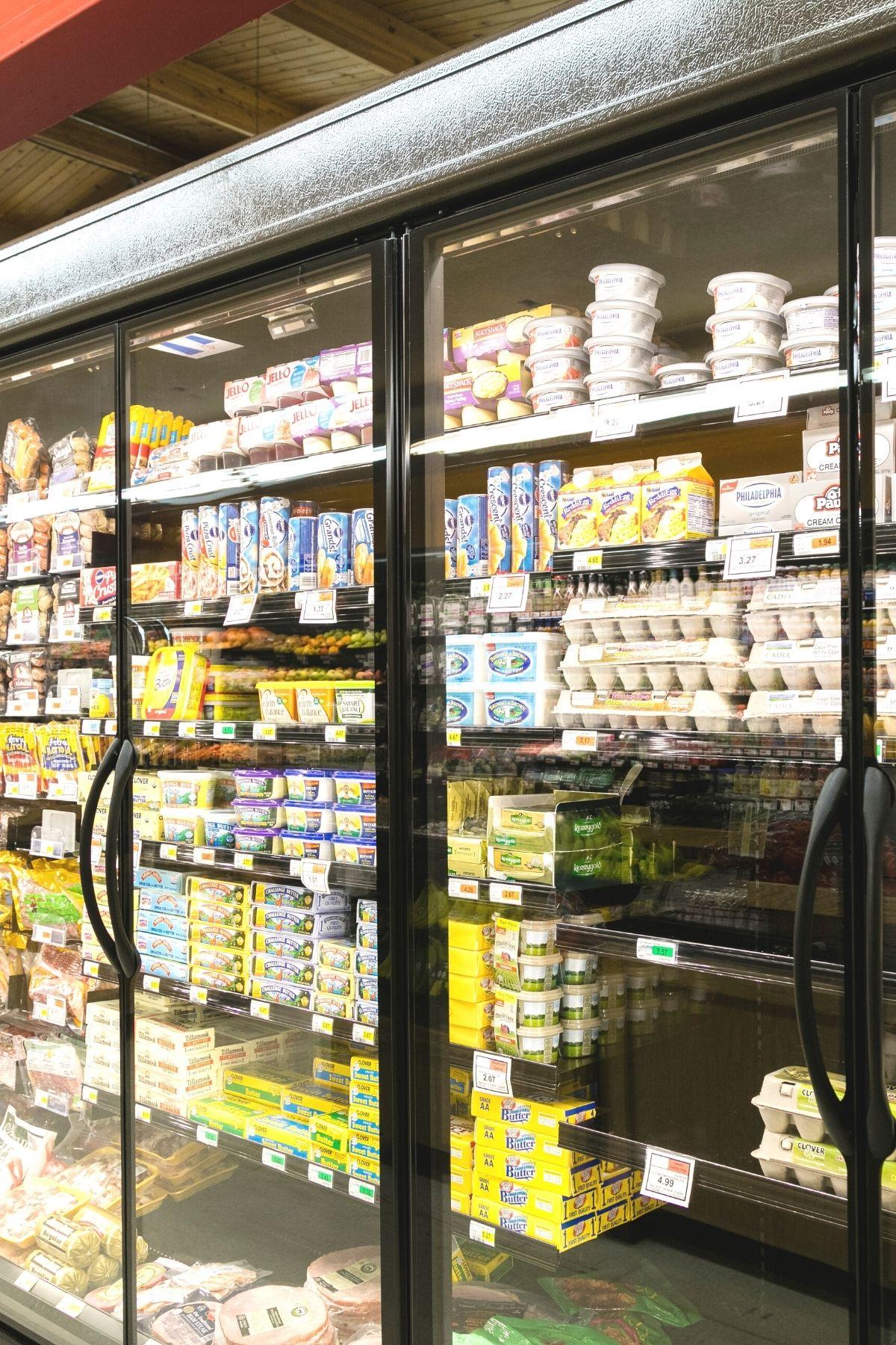 refrigerator grocery aisle