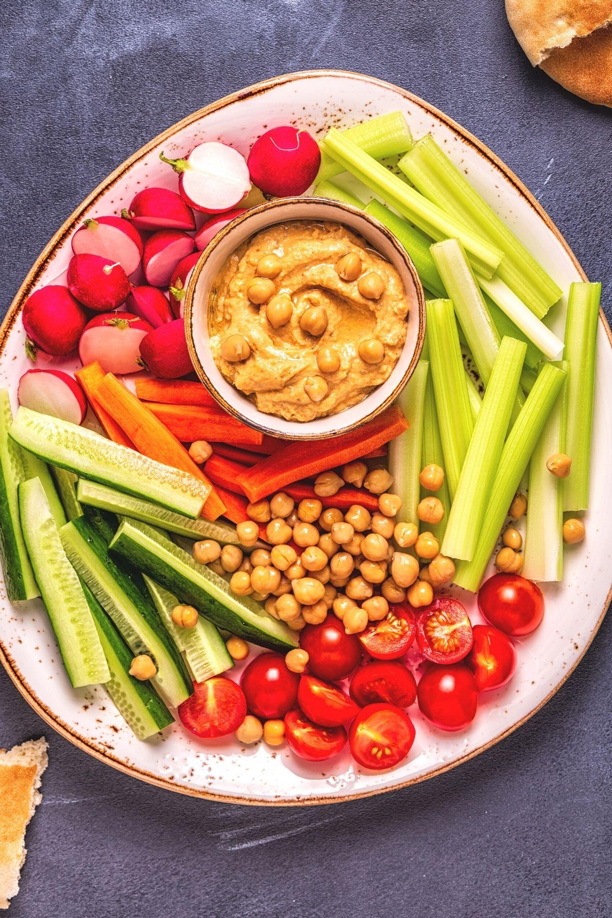 photo with platter of hummus and veggies