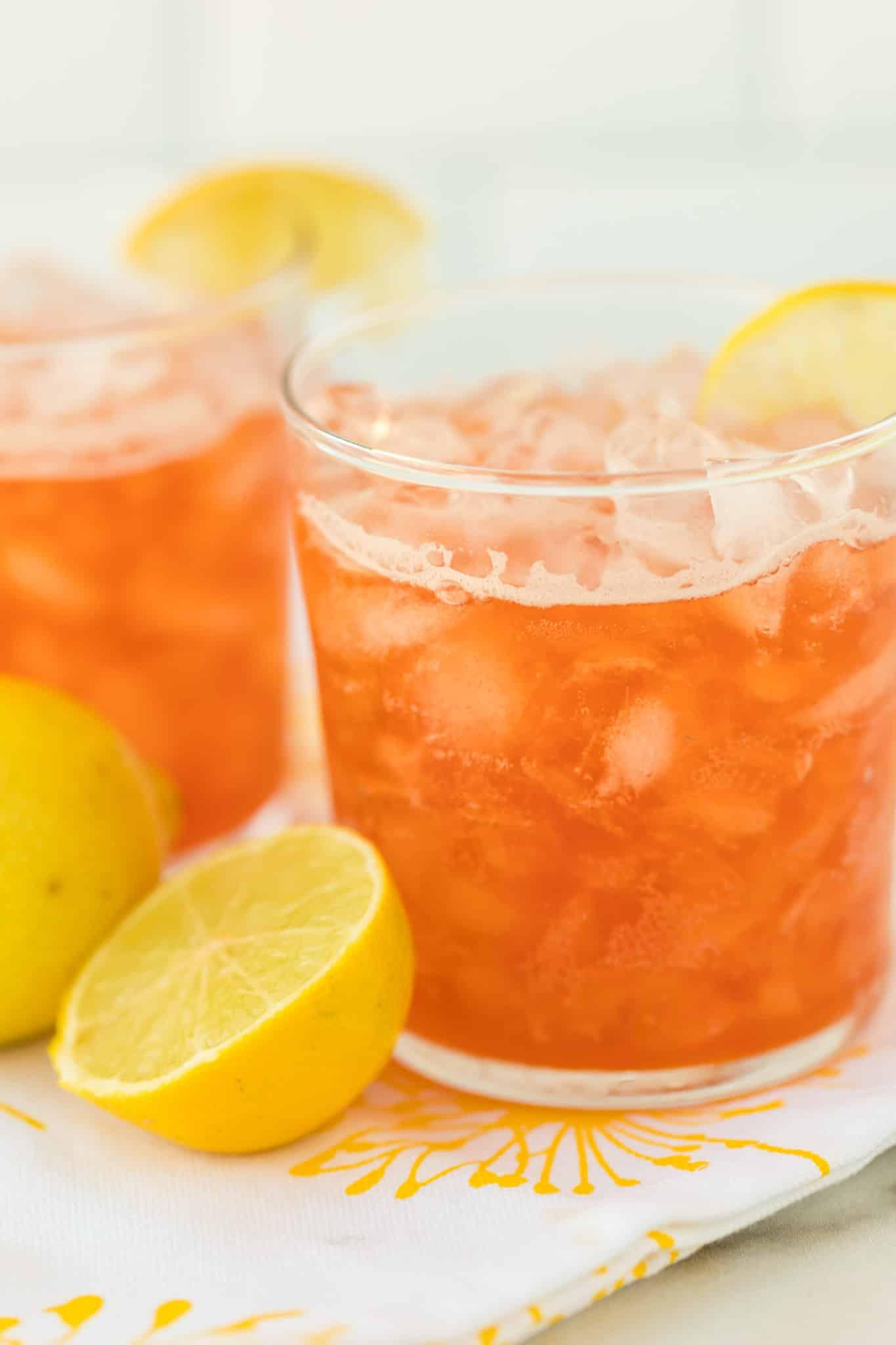 two glasses of kombucha lemonade with fresh lemon slices