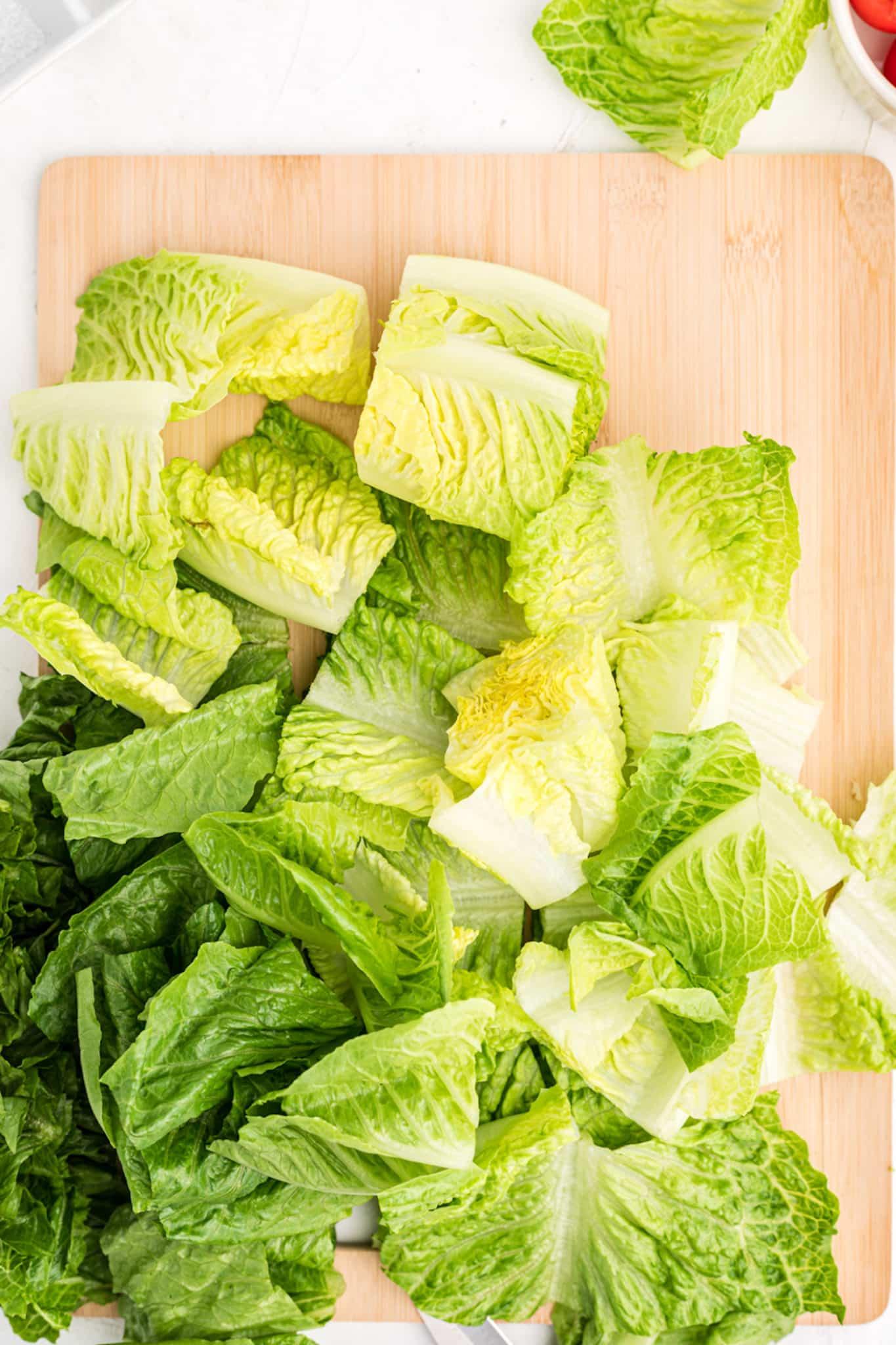 chopped romaine lettuce on a cutting board