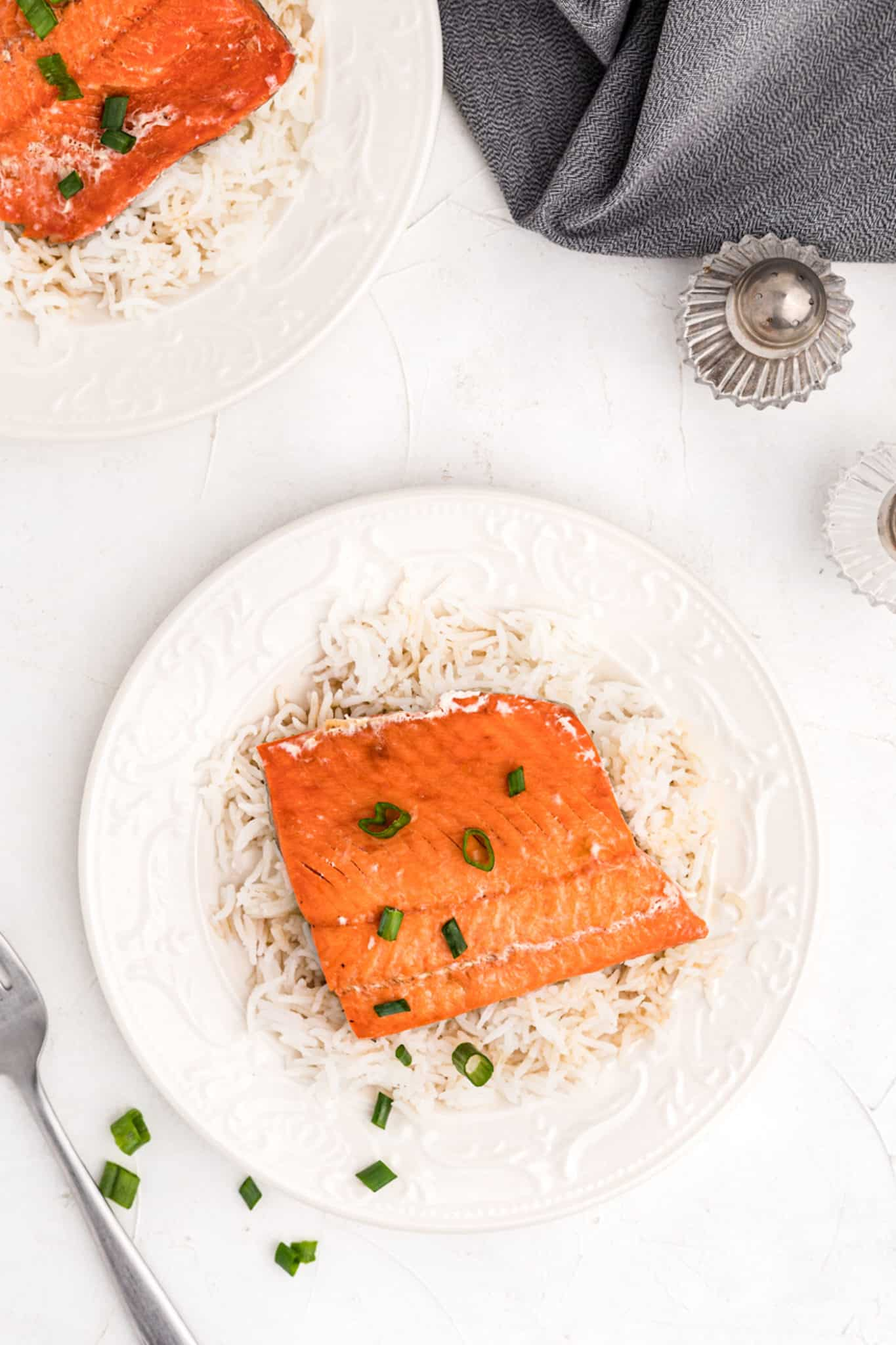 overhead photo with cooked salmon and rice on a serving plate