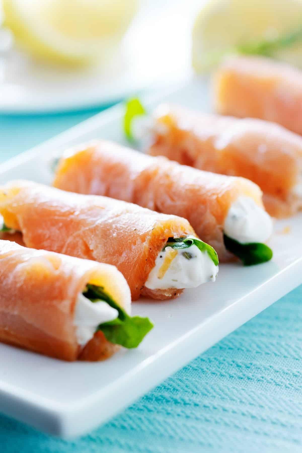 smoked salmon wraps on a plate