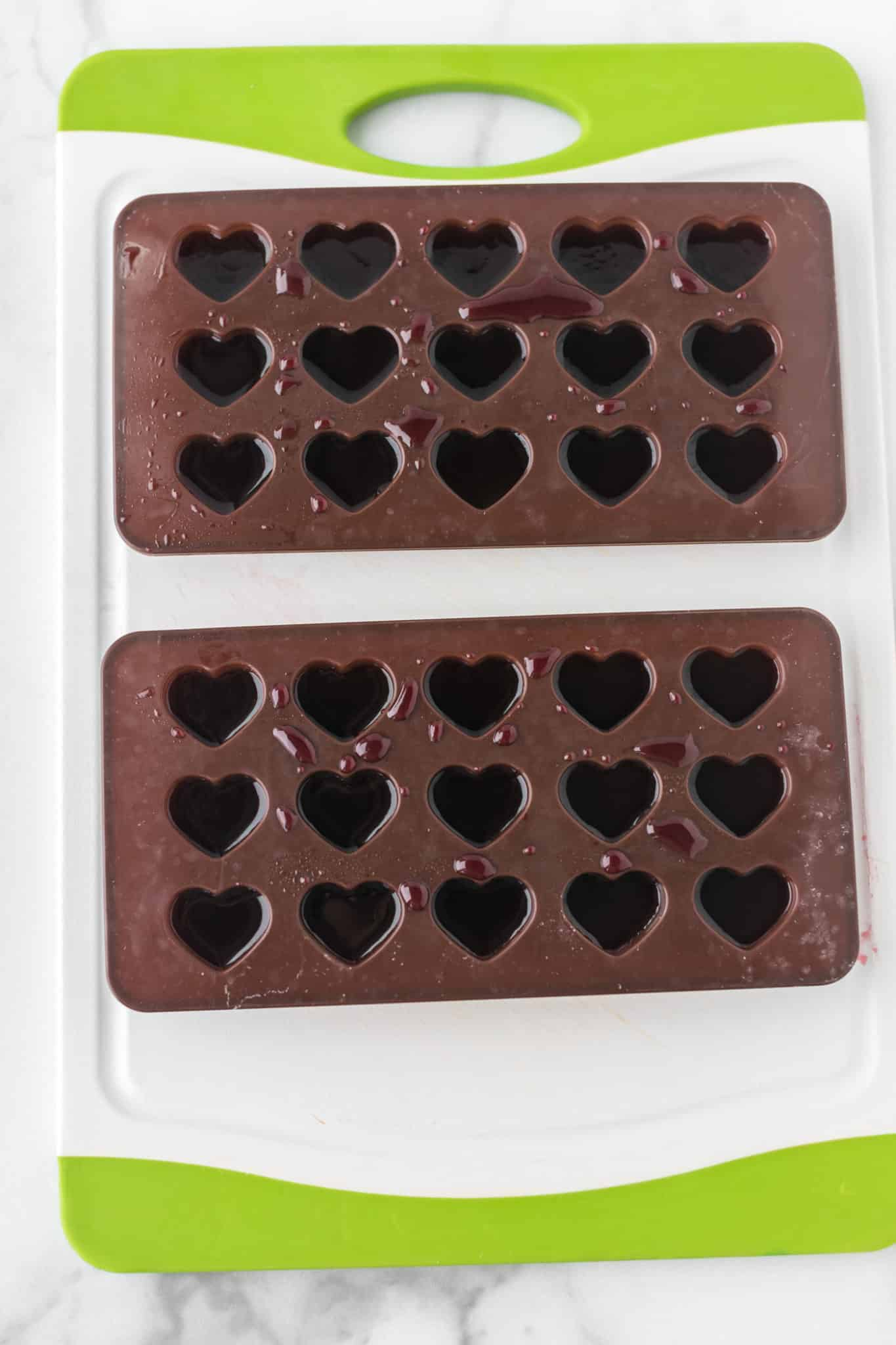 gummy mixture in heart shaped molds