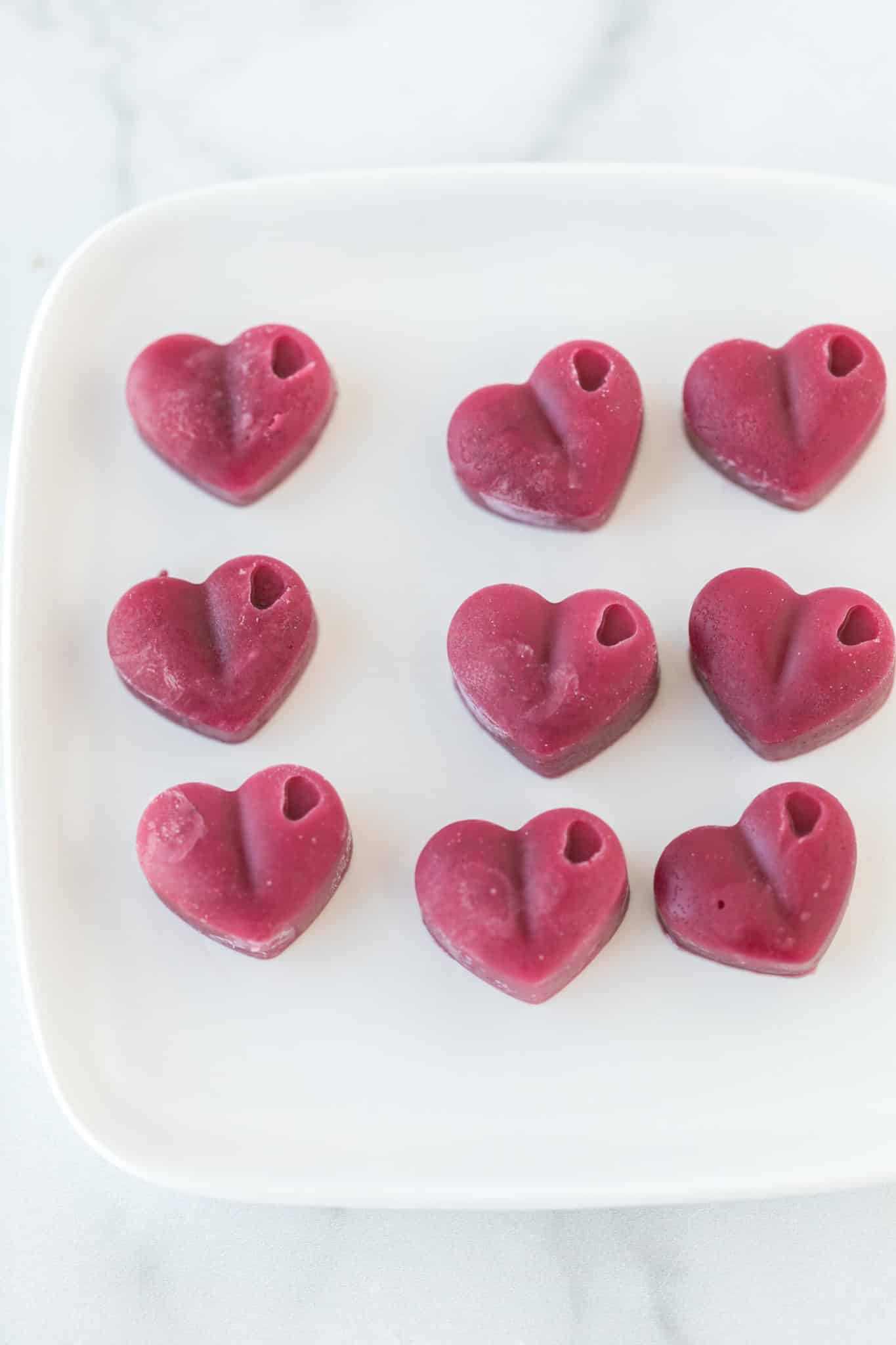 plate with pink heart-shaped gummies