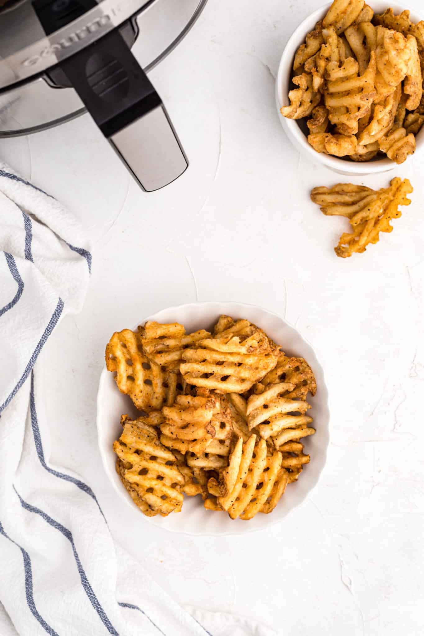 waffle fries served in two bowls