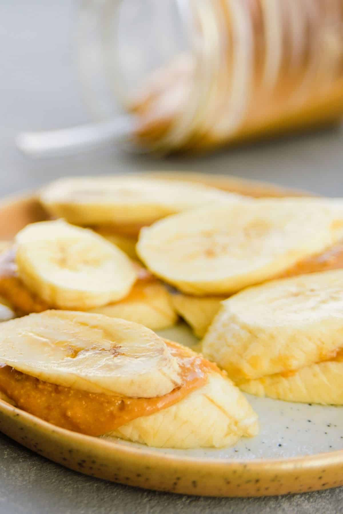 sliced banana with peanut butter