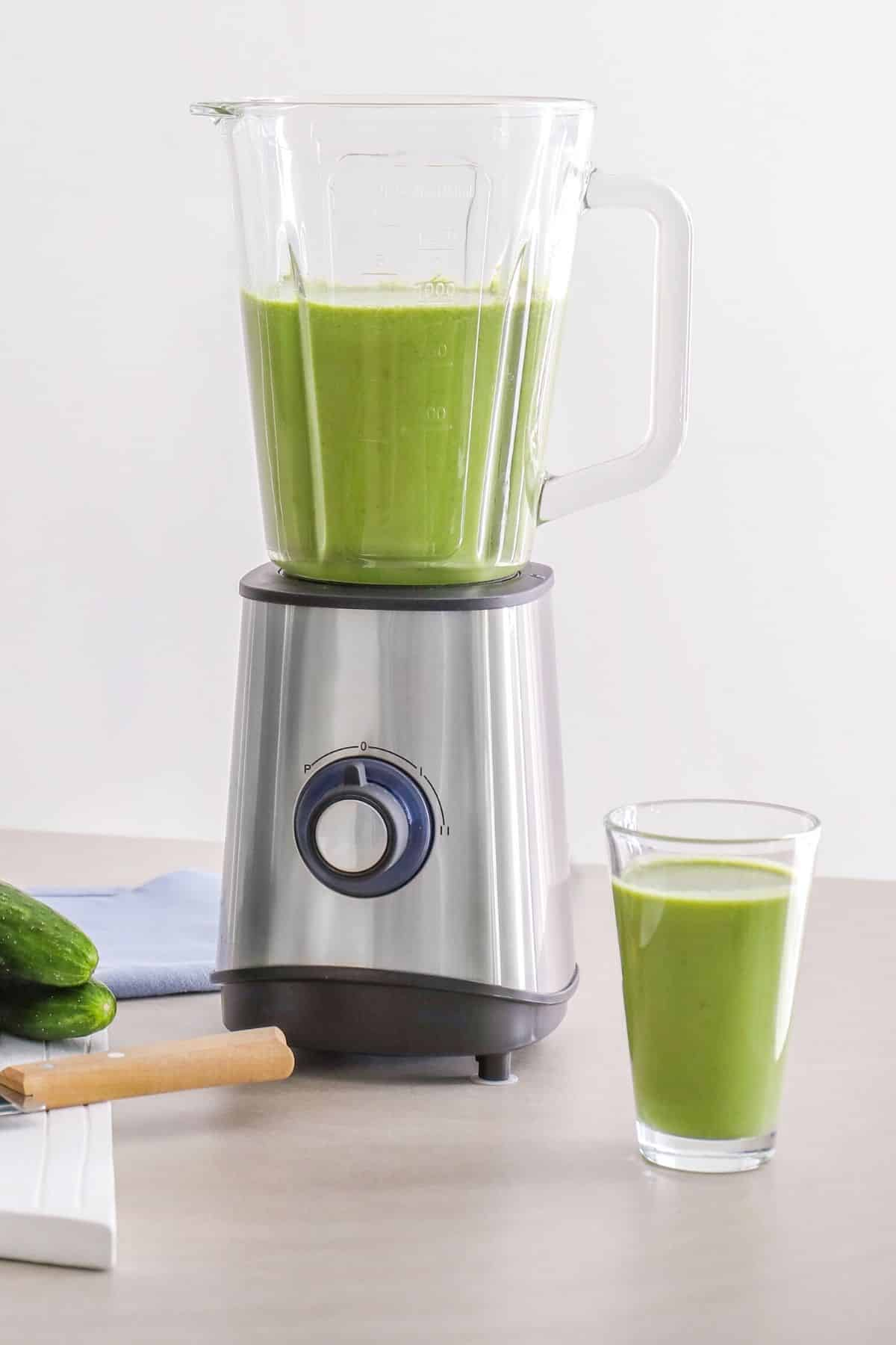 blender filled with green smoothie