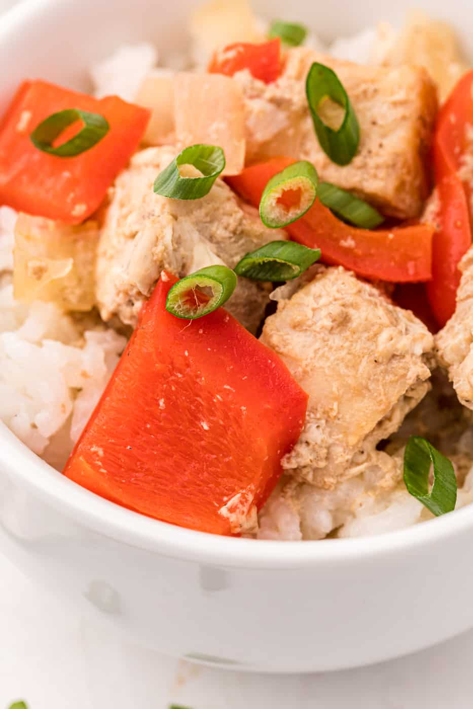 cooked mahi mahi and bell peppers in a bowl