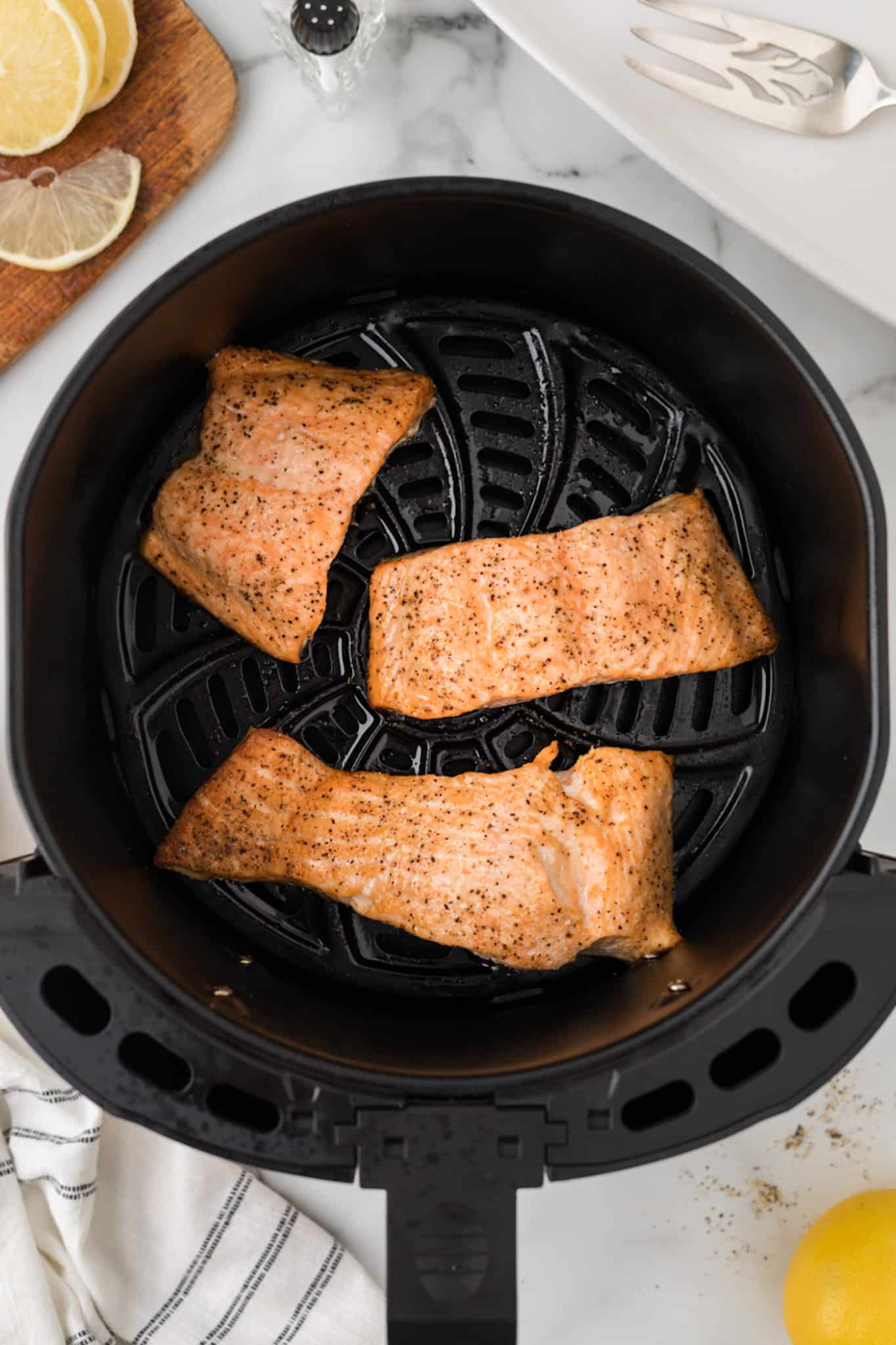 cooked salmon fillets in an air fryer