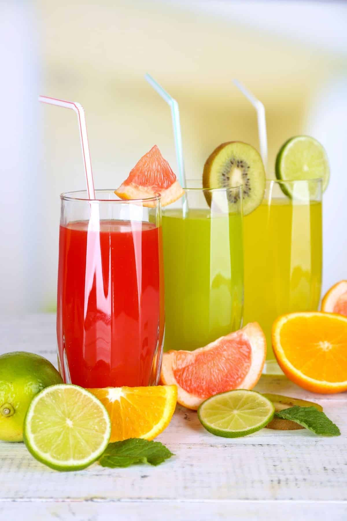 fresh fruit juices in glasses on a table