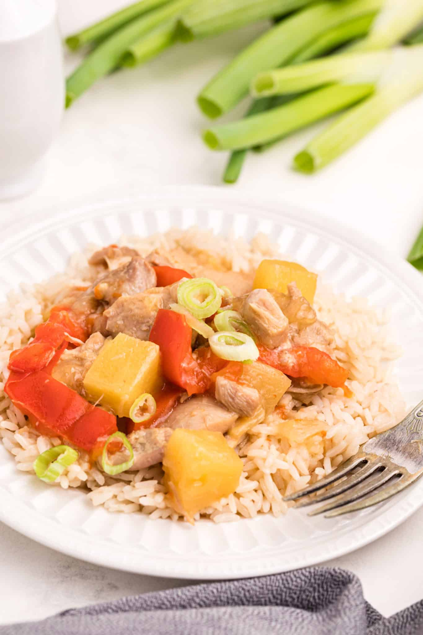 cooked chicken, pineapple, and rice on a plate