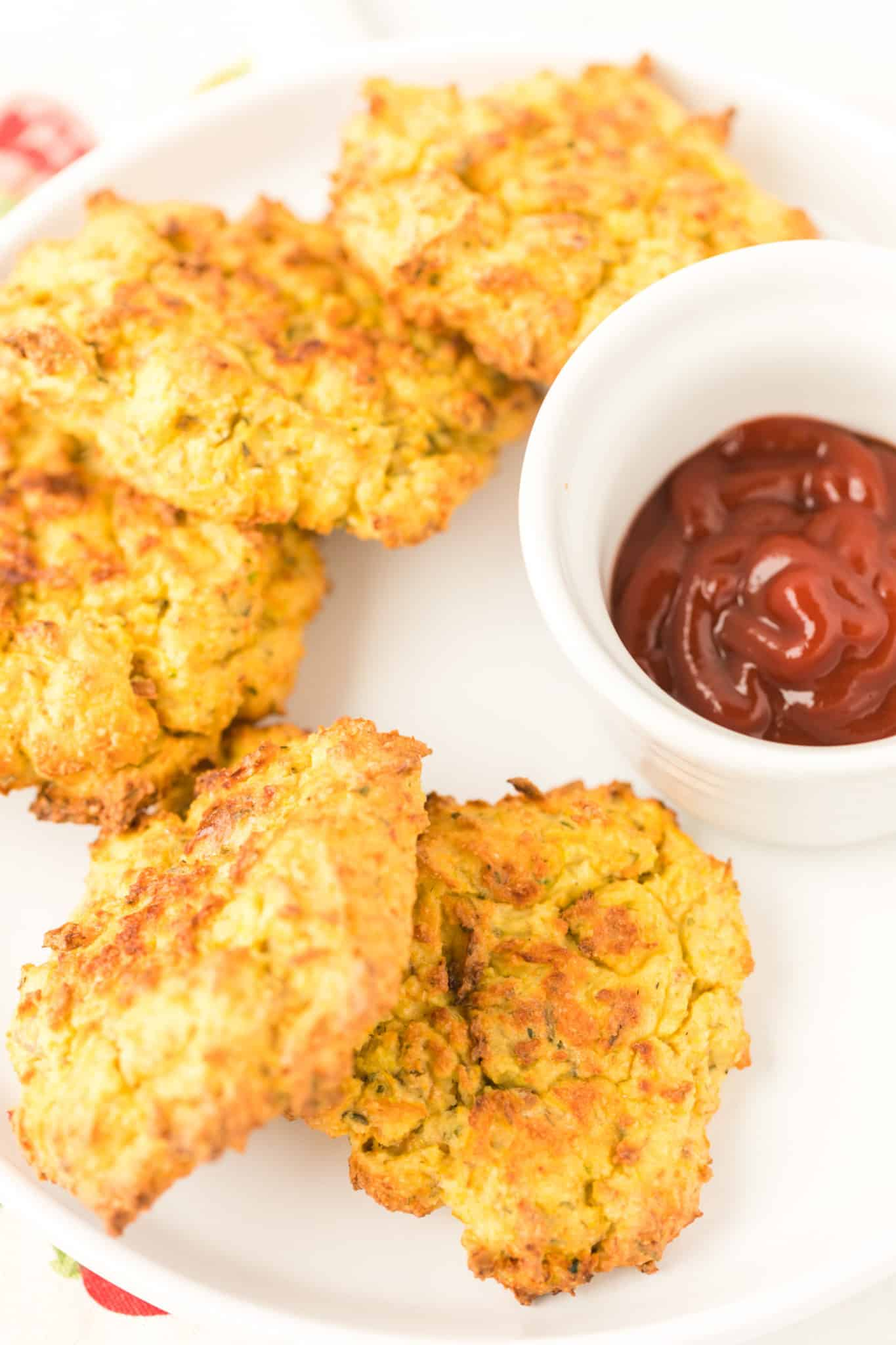 plate of potato fritters with ketchup
