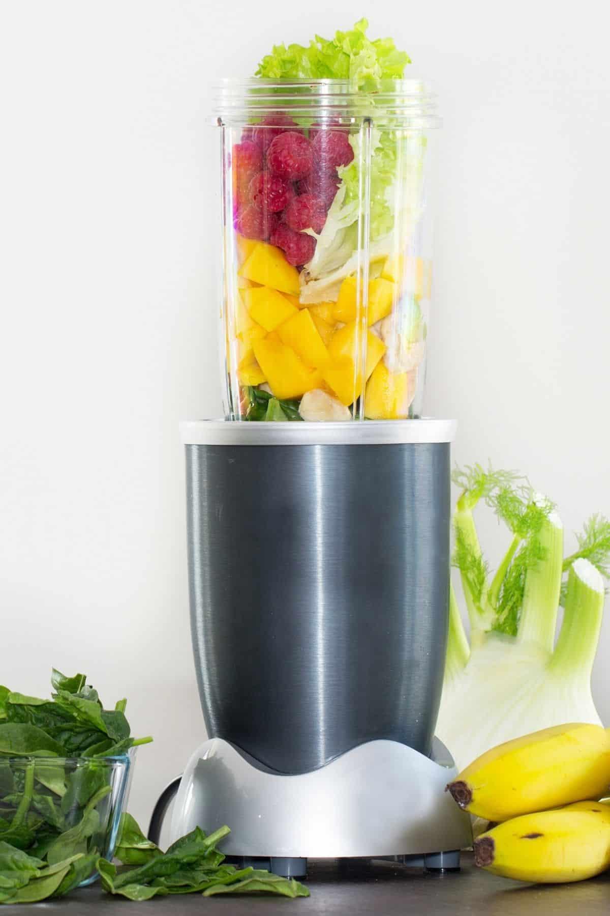 single serve blender filled with fruit