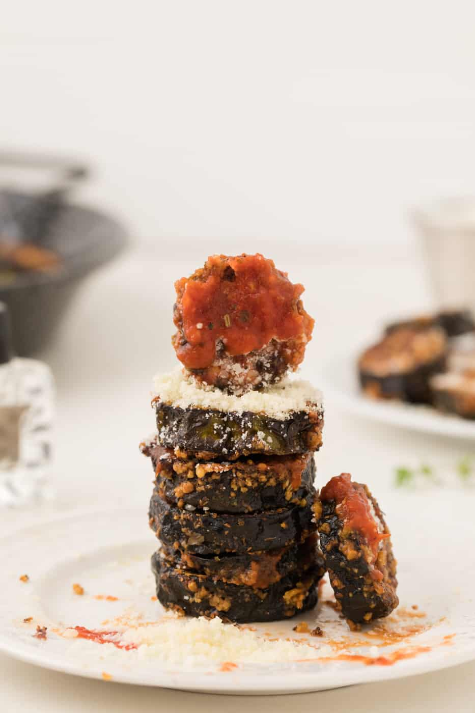 stack of cooked air fryer zucchini slices with marinara and parmesan