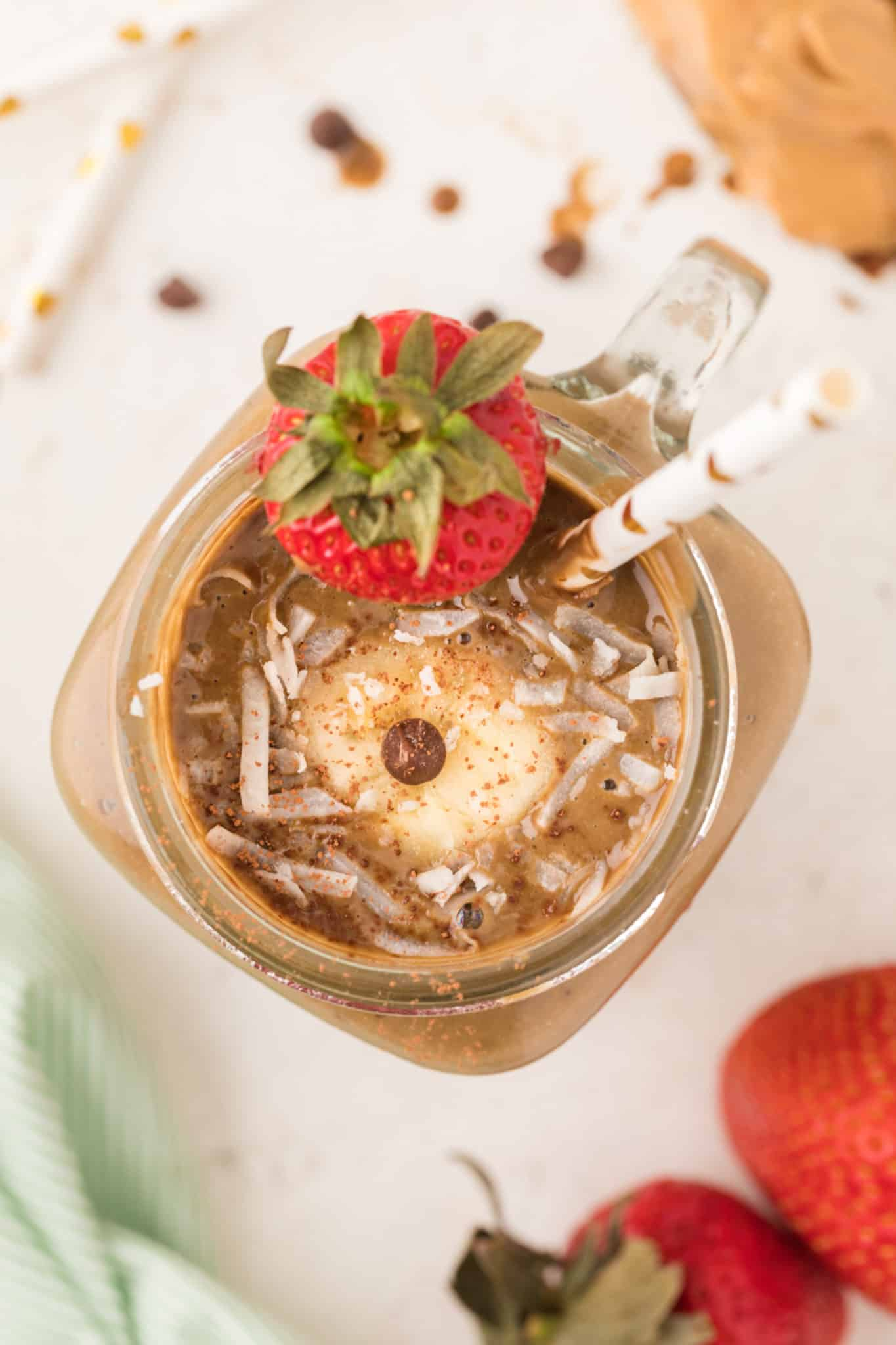 chocolate smoothie served with fresh strawberries