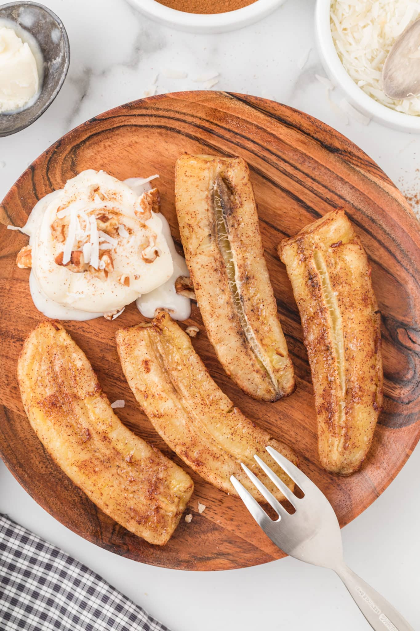 air fried bananas on a wooden plate with ice cream