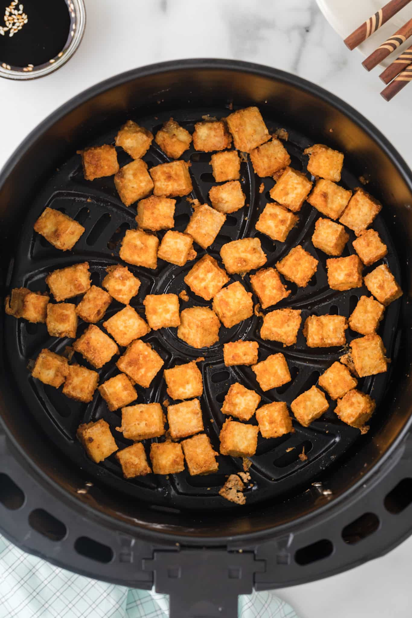 crispy tofu in air fryer basket