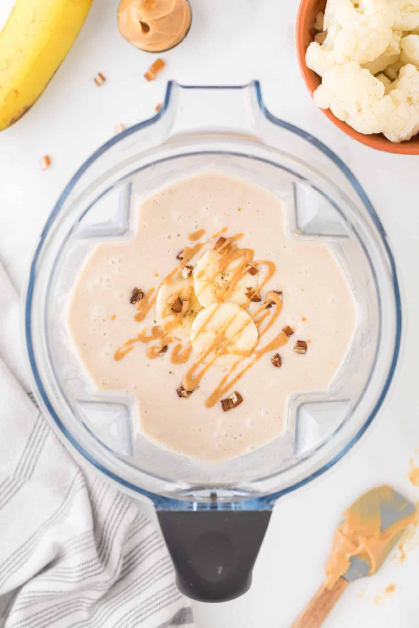 blended cauliflower smoothie in vitamix with toppings