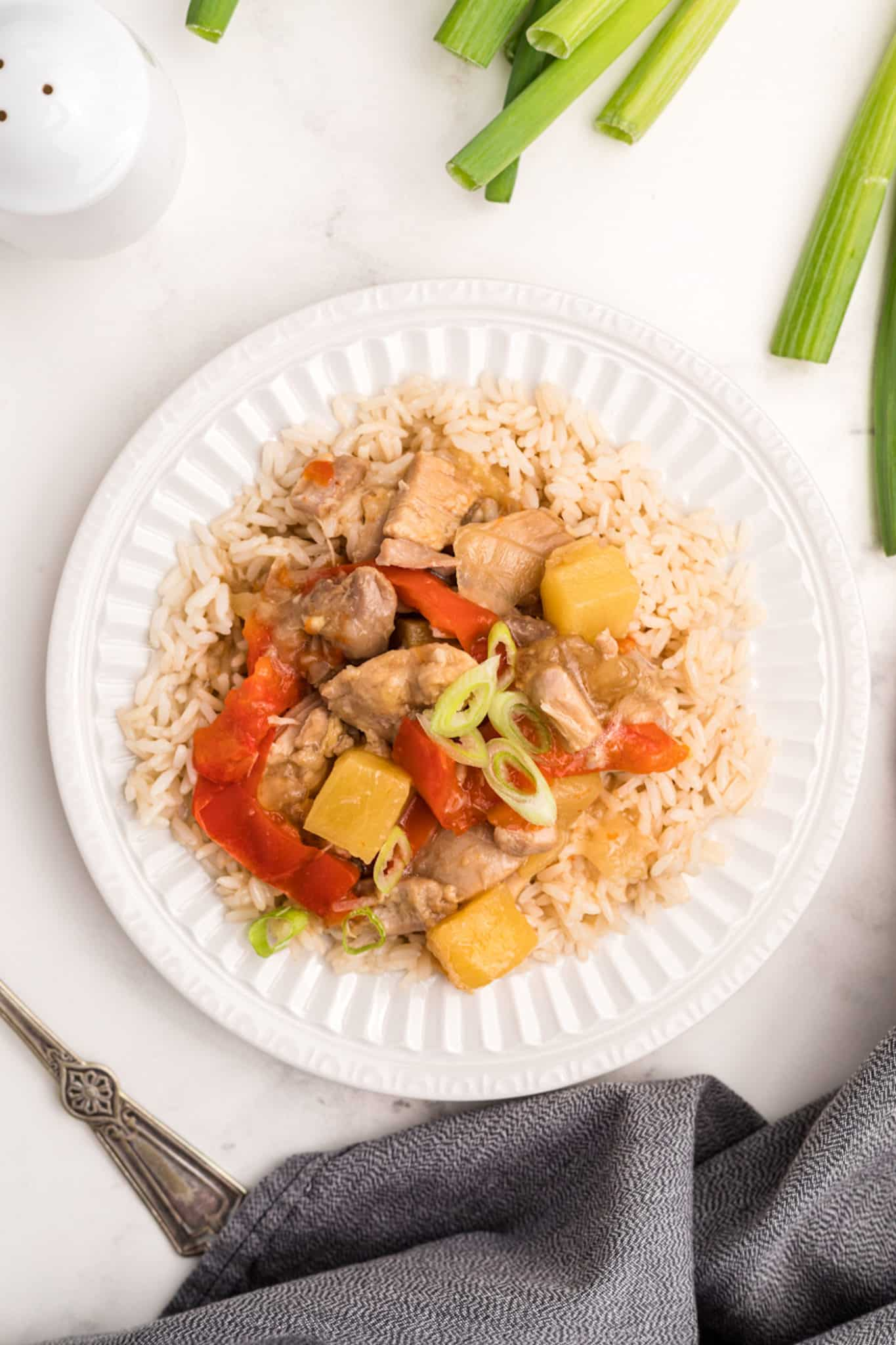 plate of pineapple chicken with veggies and steamed rice