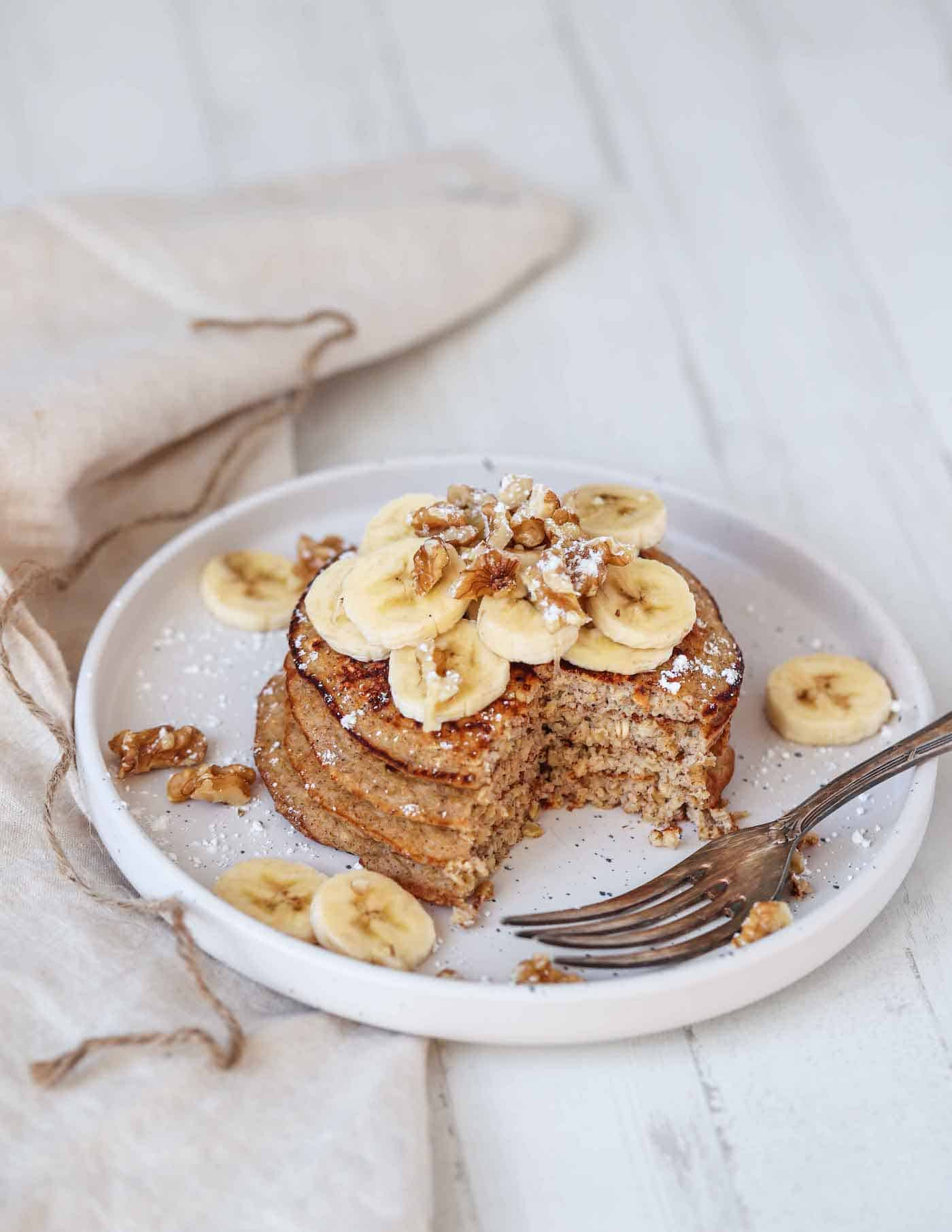 protein pancakes topped with banana slices